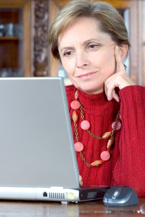 Adult woman using laptop